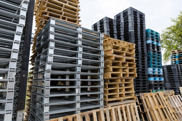 different types of pallets stacked in a row